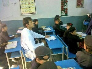 Imran Khan sitting in a class room